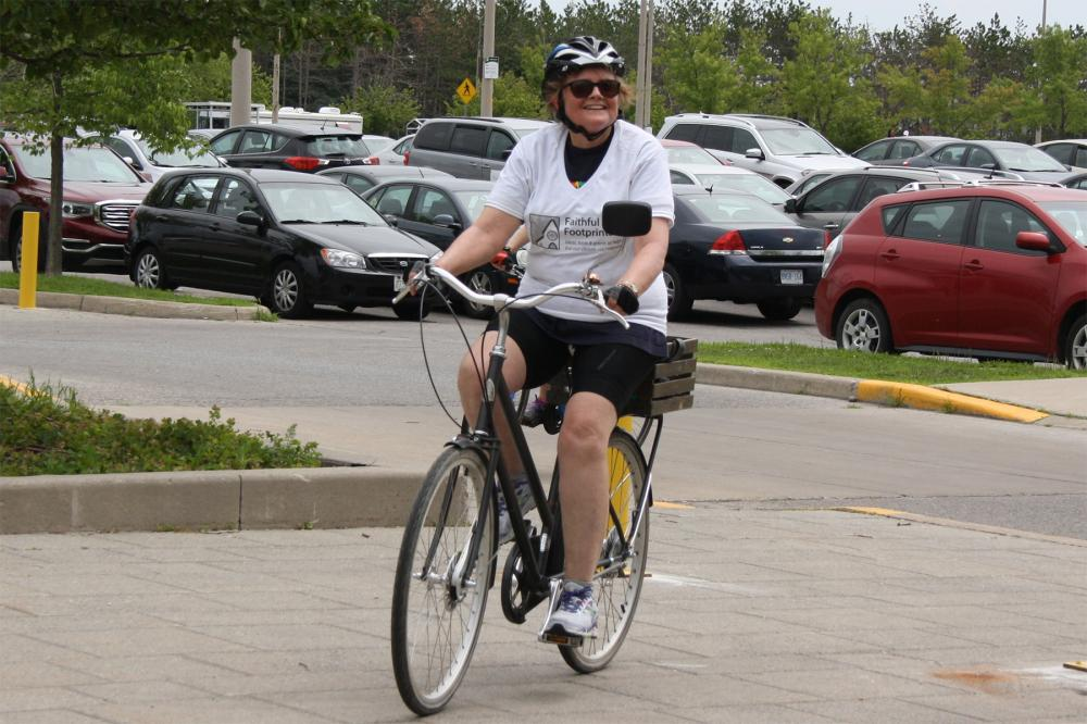 Photo of former Moderator Mardi Tindal biking in to GC43